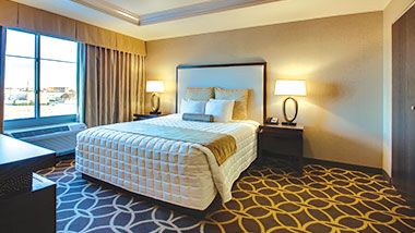 A king size bed in the deluxe suite at Zia Park Casino, Hotel and Racetrack.