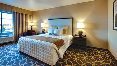 An extended room with a king size bed at Zia Park Casino, Hotel and Racetrack.