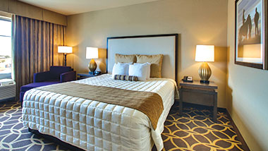 A deluxe room with a king size bed at Zia Park Casino, Hotel and Racetrack..