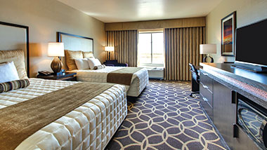 A deluxe room with two queen size beds at Zia Park Casino, Hotel and Racetrack..